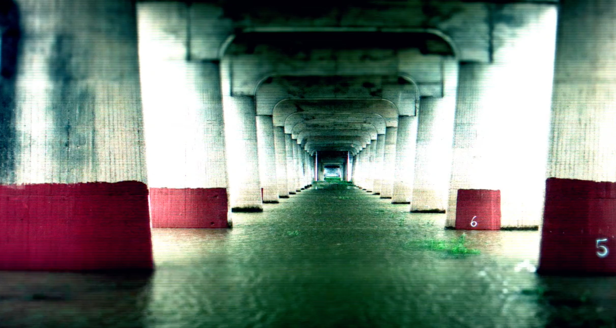 Under a bridge, flooded by recent rains